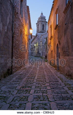 Cobbled alleyway of old city lit up at night - Stock Photo