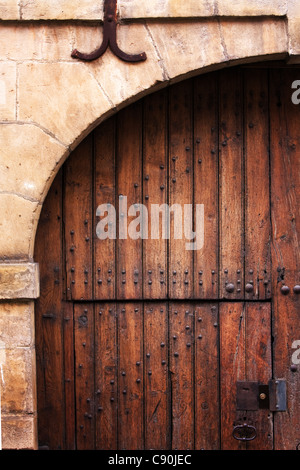 Old Wooden arched door in Charleville-Mézières France - Stock Photo