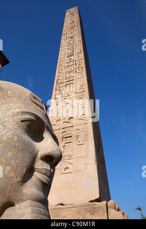 Obelisk and colossal statue of Ramesses II in the entrance area of Luxor Temple, Luxor, Egypt, Africa - Stock Photo