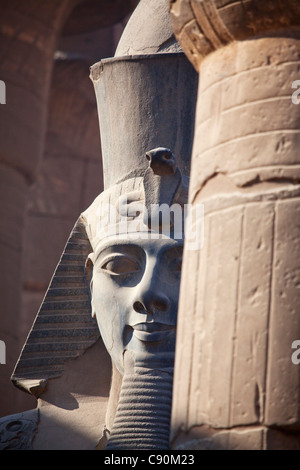 Colossal statue of Ramesses II in the entrance area of Luxor Temple, Luxor, Egypt, Africa - Stock Photo