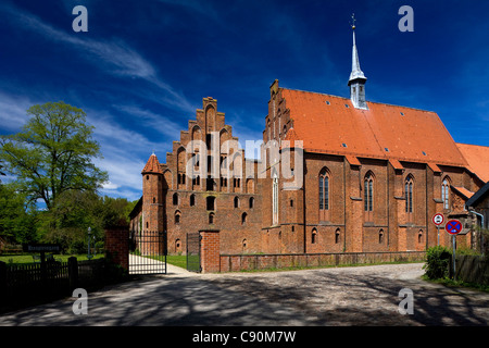 Wienhausen Convent under blue sky former Cistercian nunnery is today an evangelical abbey Wienhausen Lower Saxony - Stock Photo