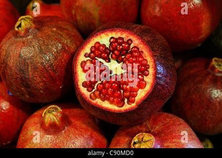 Close up of pomegranates, Market hall, Port Louis, Mauritius, Africa - Stock Photo