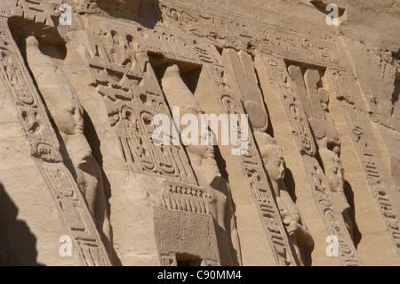Egyptian art. Temple of Hathor or Small Temple. Facade with the pharaoh Ramses II and his wife Nefertari. Abu SImbel. - Stock Photo