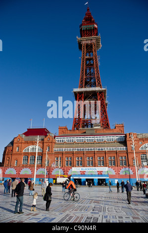 People standing on the Comedy carpet on Blackpool Promenade - Stock Photo