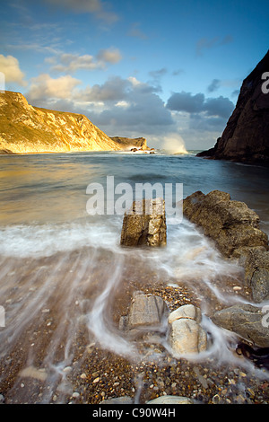 Man of War Bay and Man O'War Cove are on the Dorset coast the Jurassic coastline and the cliffs are a draw for fossil - Stock Photo