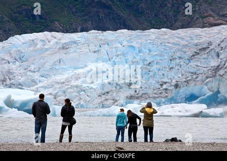 Tourists contemplating Mendenhall glacier. Juneau. Alaska. USA - Stock Photo