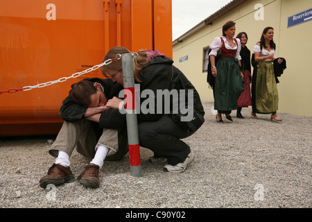 Over drunken visitor at the Oktoberfest Beer Festival in Munich, Germany. - Stock Photo
