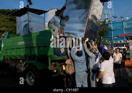 Floating toilet for flood victims is loaded on relief truck. National Stadium, Bangkok, Thailand on Monday, November - Stock Photo