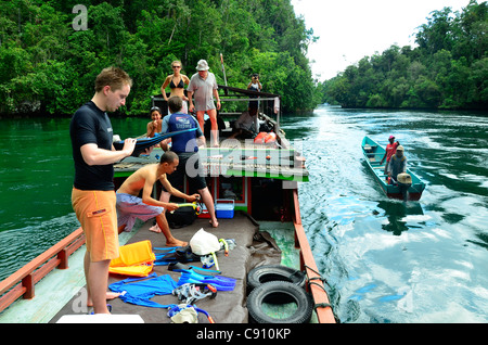 Tourists prepare to snorkel in The Passage, Raja Ampat islands near West Papua, Indonesia in the coral triangle, - Stock Photo