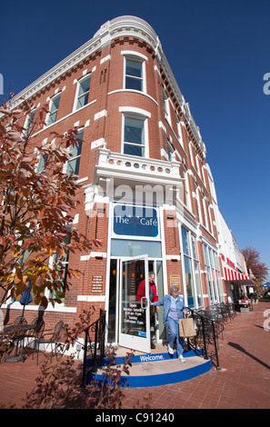 Visitors exit The Spark Cafe at the Walmart Visitor's Center in downtown Bentonville, Ark. - Stock Photo