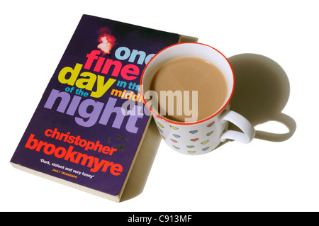 One Fine Day in the Middle of the Night by Christopher Brookmyre with a mug of tea - Stock Photo