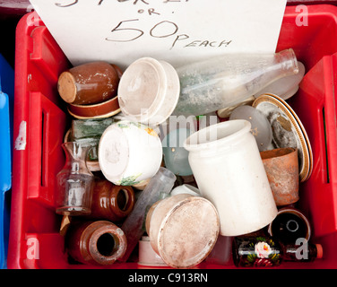 Junk shops or antique stalls in markets in London often sell old fashioned ceramic jars and bottles. - Stock Photo