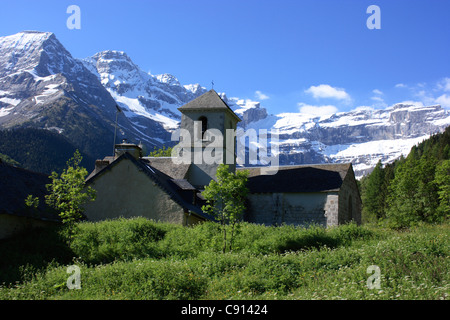 The Chapel of Notre Dame is a small historic pilgrim chapel in the Haute Pyrenees valley in the Cirque de Gavarnie - Stock Photo