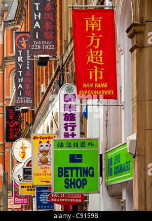 Colourful signs on buildings in the Chinatown area of Manchester city centre England UK - Stock Photo