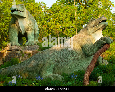 Sculpture of dinosaurs in Crystal Palace Park south London UK made by Benjamin Waterhouse Hawkins and Richard Owen - Stock Photo