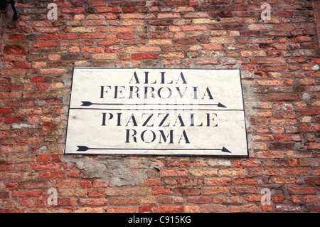 Venice has many old fashioned signs which offer directions around its myriad of complicated streets and pathways. - Stock Photo