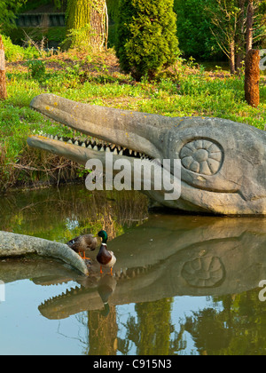 Sculpture of dinosaur in Crystal Palace Park south London UK made by Benjamin Waterhouse Hawkins and Richard Owen - Stock Photo