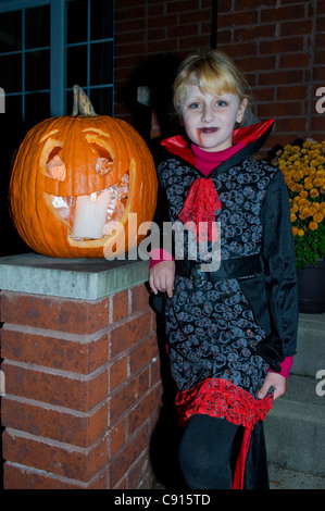 Girl with pumpkin at Halloween time Montreal canada - Stock Photo