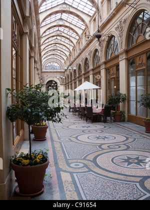 The Galerie Vivienne shopping arcade opened in 1826 and remains one of the Parisians' favorite place to go shopping. - Stock Photo