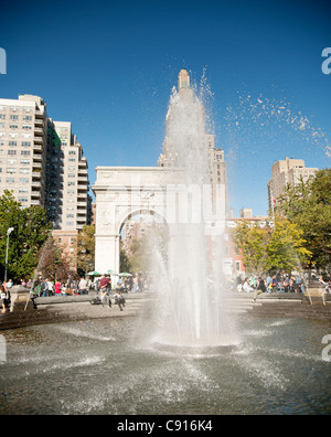 Washington Square park is a popular public park surrounded by New York University buildings. The centre of the square - Stock Photo