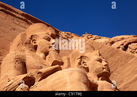 The Abu Simbel temple is an archaeological site comprising two massive rock temples in southern Egypt on the western - Stock Photo