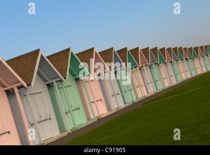 A row of pastel coloured beach huts on the sea front at Southsea. - Stock Photo