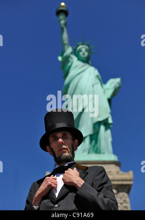 Abraham Lincoln in front of the Statue of Liberty, Manhattan, New York City, New York, USA, North America, America - Stock Photo