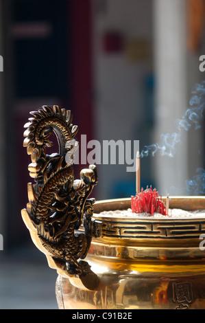 Burning incense sticks in a Chinese Temple, Petaling Street, Kuala Lumpur, Malaysia, Asia - Stock Photo