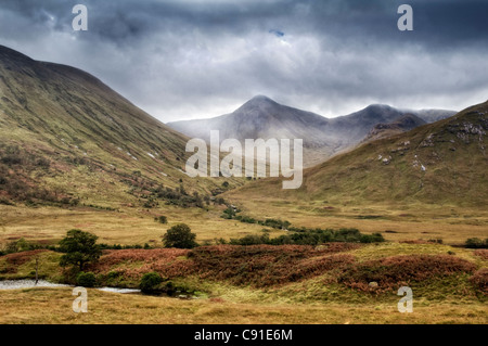 Glen Etive, Glencoe region in Scotland with mist and rain coming in, taken in early autumn - Stock Photo