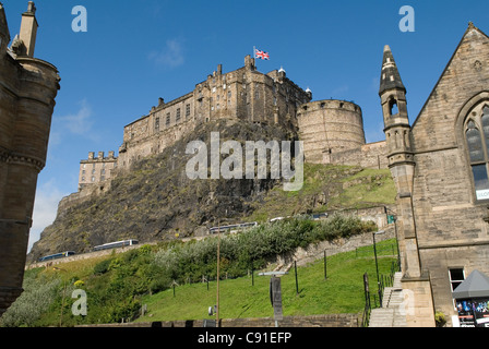 Edinburgh Castle is a fortress which dominates the skyline of the city of Edinburgh from its position on top of - Stock Photo