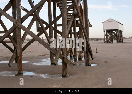 Buildings on stilts, beach at low tide, St Peter-Ording, Schleswig-Holstein, North Sea coast, Germany - Stock Photo
