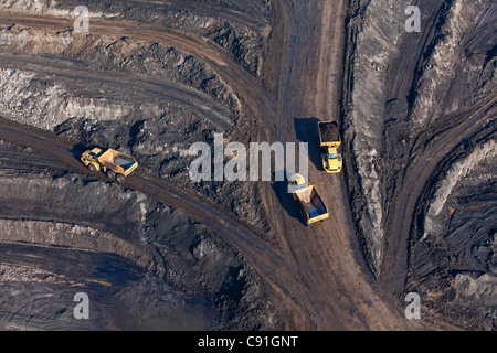 Aerial view of an open-pit lignite mine, Lorries transporting brown coal, Schoeningen, Lower Saxony, Germany - Stock Photo
