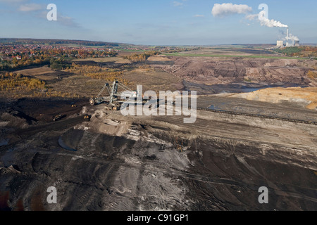 Aerial view of a bucket-wheel excavator with conveyor belt in for open-pit lignite mining brown coal Schoeningen - Stock Photo