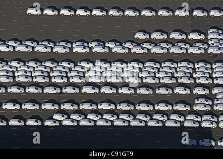 Aerial view of new vehicles waiting to be loaded at Emden harbour, Emden, lower Saxony, northern Germany