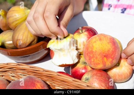Close up of half-eaten apple on table - Stock Photo