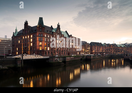 Sandthorquaihof in the evening, Speicherstadt, Hanseatic city of Hamburg, Germany, Europe - Stock Photo