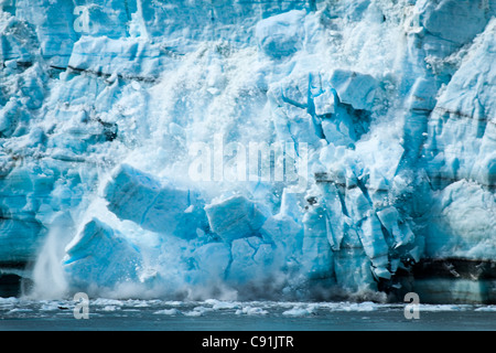 Close up of Margerie Glacier calving with huge piece of ice falling, Glacier Bay National Park & Preserve, Southeast - Stock Photo