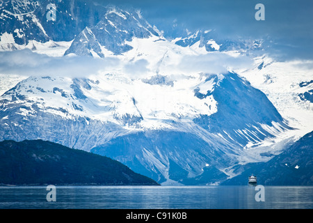 A small cruise ship sailing through Tarr Inlet with the Fairweather Range in the background, Glacier Bay National - Stock Photo