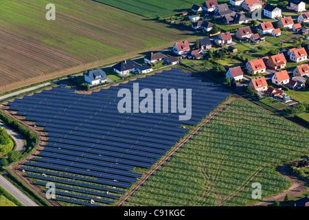 Aerial view of solar panels near Holzminden, housing settlement, Lower Saxony, Germany - Stock Photo