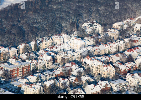 Aerial view of Hannover in the winter snow, city flats on the edge of Eilenriede city forest, Lower Saxony, Germany - Stock Photo