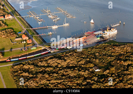 Aerial of ferry dock and island, East Frisian island, Langeoog, Lower saxony, northern Germany - Stock Photo