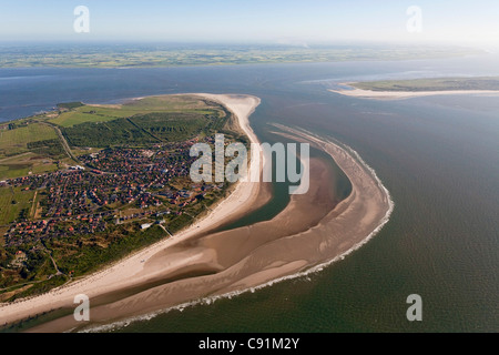 Aerial of North Sea island, Spiekeroog and mainland in background, Lower Saxony, Germany - Stock Photo