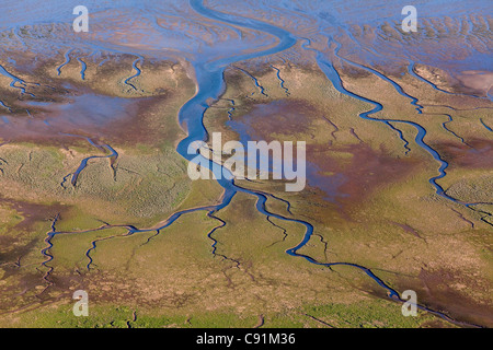 Aerial of a tidal inlet in mudflats, Wadden Sea, Lower Saxony, Germany - Stock Photo