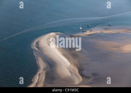 Aerial of yachts anchored on a sandbank, Wadden Sea, Lower Saxony, Germany - Stock Photo