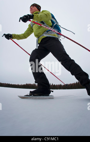 Woman nordic ice skating at Nancy Lake, Winter in Southcentral Alaska - Stock Photo