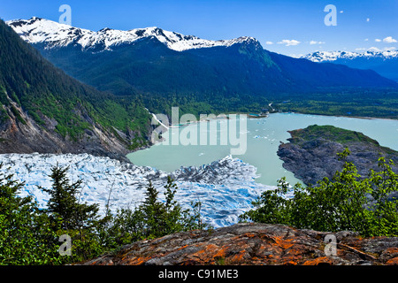 Scenic view overlooking Mendenhall Glacier and Mendenhall Lake from West Glacier Trail, Juneau, Southeast Alaska, - Stock Photo