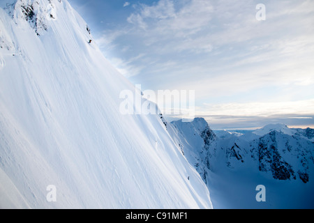 Man skiing steep powder on the southwest face of Kickstep Mountain, Turnagain Pass, Kenai Mountains in Southcentral - Stock Photo