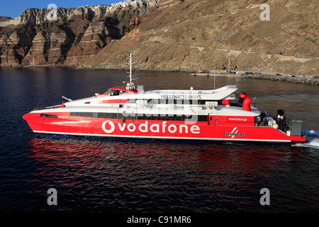 greece cyclades santorini vodafone flying cat 4 departing the port of athinios - Stock Photo