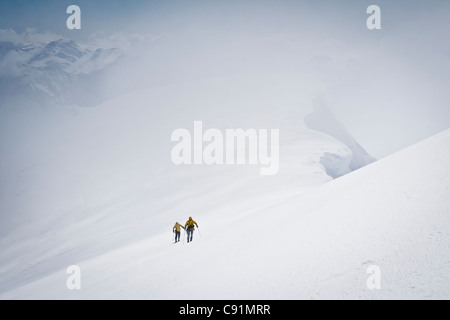 Skiers skiing to the summit of Mount Gerdine in the Tordrillo Mountains, Winter in Southcentral Alaska - Stock Photo