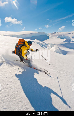 Backpacker skiing powder on Trimble Glacier, Tordrillo Mountains, Winter in Southcentral Alaska - Stock Photo